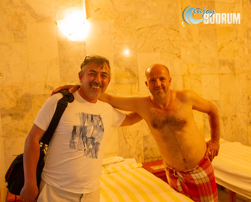 Posing with the tellak - the male masseur - in Turkish Bath in Bodrum